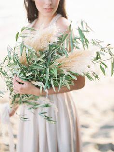 Wheat and olive branch bouquet: http://www.stylemepretty.com/washington-weddings/2015/07/24/golden-hour-on-the-washington-coast-wedding-inspiration/ | Photography: Christine Clark - http://www.christineclarkphoto.com/