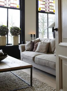 Living room #modern #country style, love the #stained glass windows!