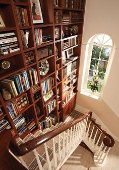 Clever! Using stairwell for bookshelves.