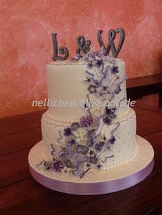 Two Tier Wdding Cake with violet flowers & butterflies