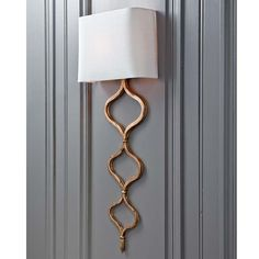 Ripple Sconce 11 Main:  A modern sconce with continuous metal weave that meets to make a 3 diamond shapes from large to small, accented by an oval shade t...