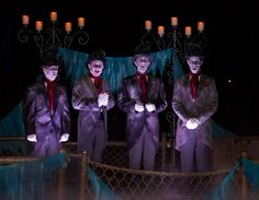 The Cadaver Dans performing from their bewitched barge on the Rivers of America.