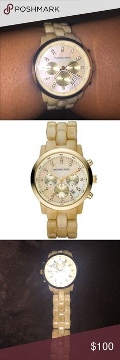 Michael Kors Mother of Pearl Watch Michael Kors Mother-of-Pearl Watch The Michael Kors Chronograph Watch, gold polyurethane and stainless steel bracelet-style band fold-over clasp to lock The dial is white, and gold-toned numeric hour markers With a durable mineral crystal Band Material: Plastic Band Width: 18mm Band Color: Beige Dial Color: Mother of Pearl Bezel Function: Stationary Calendar: Date Special Features: Chronograph, includes a seconds-hand Movement: Quartz Water Resistant Depth…