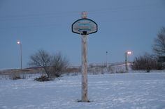 neildacosta:  Hoops on the Reservation. On Pine Ridge Indian Reservation basketball reigns supreme. Known to the locals as Rez Ball it is a unifier in the community and residents set up hoops any way they can.  On the fourth day those that have pledge to be pierced do so. We lay them on beds of sage on top of a blanket facing the sacred tree and then the medicine man will pinch up a section of skin and muscle usually on the chest just above the nipples but some have it done on the backs near…