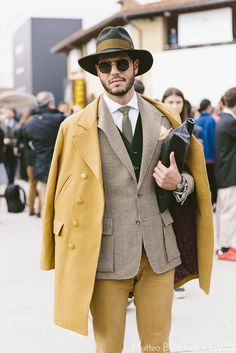 Pitti Uomo | Men's Fashion | Menswear | Men's Outfit for Business | Fall/Winter Look | Stylish and Sophisticated | Yellow Coat | Moda Masculina | Shop at DesignerClothingFans.com