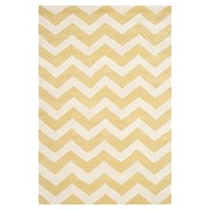 Anchor your living room or home office with this hand-tufted wool rug, showcasing a chic chevron motif in light gold and ivory.  Pro...