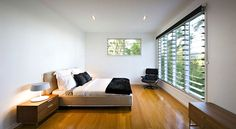 Incredible Bedroom Interior In Modern Minimalist Completed With Iconic Eames Chair Design Cream Bedding Ideas With Wooden Sideboard lounge design Architecture Résidentielle, Serene Bedroom, Minimal Bedroom, Lounge Design, Australian Homes, Eames Chairs, Design Moderne, Sunshine Coast, White Houses
