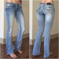 Light Wash, Distressed Lace, Miss Me Jeans Worn a few times, still in great condition. The design on the back is a distressed lace style. It is frayed with little sequins sewed in. There are jewels on the pockets. I love these jeans so I am firm on the price. Miss Me Jeans Boot Cut