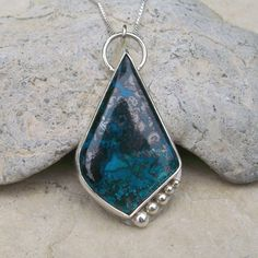 This freeform chrysocolla sterling silver pendant was among my favourites of the pendants that sold last year. Others are available in my shop at www.hevansgems.etsy.com .