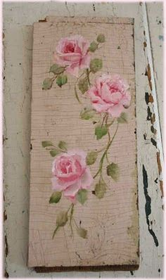 Pink roses on an old piece of time-worn wood by Jo-Anne Coletti.