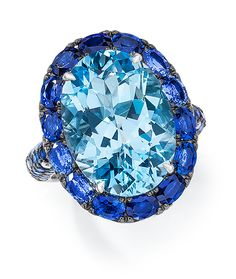 Cellini Jewelers Oval Blue Topaz and Blue Sapphire Ring.  Set in 18 Karat White Gold.
