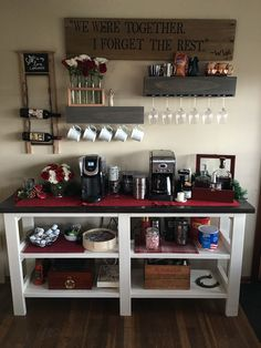 It's better built at home. Coffee bar. Floating shelves with hooks for mugs and built in slots for wine glasses. Rustic barn wood with quote. Test tube style flower holder.
