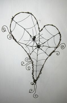 Lovey little spider web. Black covered wire bent into shape with black cording to make web. Easy!