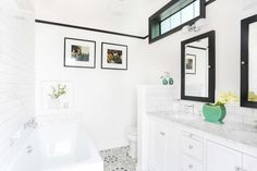 """To say that this was an extensive reno is an understatement. Before our designer Stefani Stein's redesign, the 1920s bungalow had low ceilings, a robin's-egg-blue, bathroom, a really sad kitchen and was listed on Redfin as having """"tons of potential!!!"""" Tour the gallery for Stefani's breakdown and prepare to be amazed."""