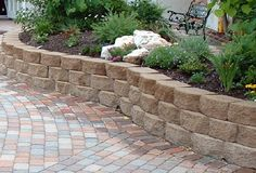 raised stone shrub beds for front  | ... walls,how to build retaining walls on a slope,brick & stone walls