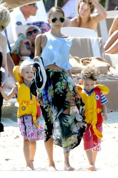 Fabulous in floral: Nicole paired her plain blue midriff-baring T-shirt with a colourful floral maxi skirt, lifting it up from the sea and sand at times to show off her slim legs Nicole Richie, Celebrity Kids, Celebrity Look, Family Affair, Mothers Love, Celebs, Celebrities, Slim Legs, Cool Kids