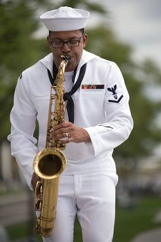 Musician 3rd Class Jason Gay, assigned to the U.S. Navy Band, Great Lakes Brass Band, plays in a concert along Detroit's downtown riverwalk as part of Detroit Navy Week.