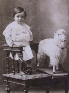 child and early toy pull lamb