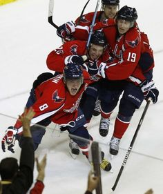 Washington Capitals' Ovechkin,  Backstrom and Semin celebrate a goal against New York Rangers during their NHL Eastern Conference hockey series in Washington