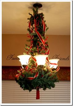easy way to decorate a chandelier with a wreath garland ribbon