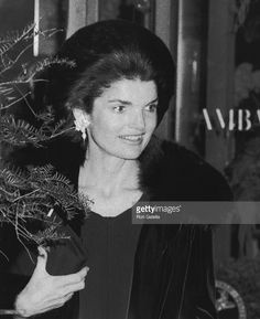 Jackie Onassis attends St. Regis Hotel 40th Anniversary Celebration on December 11, 1975 at the Ambassador Flower Shop at the St. Regis Hotel in New York City.