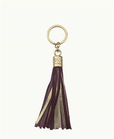 Fun and functional key chain highlighting our tassel and signature hardware.