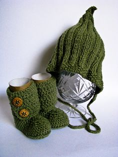 This adorable Baby Gift Pack includes a Ribbed Pixie Hat and Ankle Booties set made in a yummy combination of stitches and colours.    This beautifully knit/crocheted Gift Pack is silky soft to touch, luxuriously warm and will look stunning shopping, at parties or for that first photo shoot.     The colours used in this Baby Gift Pack is Sage. Both Hat and Booties can be accented with a flower, for the girls.    This Baby Gift Pack is designed for babies 0 to 6 months or 6 to 12 months old.