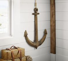 Hand carved and finished for an antique look, this character-rich piece brings seaside style to any room. 26
