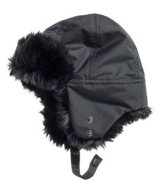fdab6b9c381 Hat with ear flaps and chin ties. Faux fur lining.