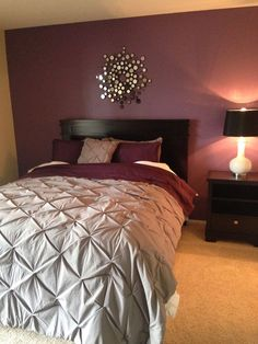 Make It Work With Purples - Deep purples and greys can be mixed together to achieve this bedroom look. Be sure to add ample lighting and some lighter touches to keep the room from becoming too dark. Simply add a grey headboard and furniture to a room painted with a dark color, and you're good to go!