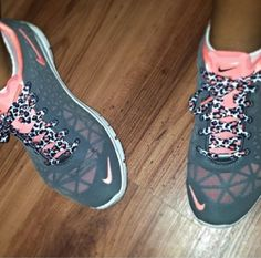 Pink and gray nikes with cheetah print laces