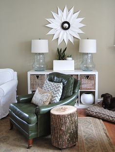 tree stump table, ikea shelves and accent chair