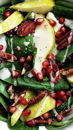 POMEGRANATE PEAR & PECAN SALAD WITH POPPYSEED DRESSING ~ Fresh spinach salad topped with pomegranate seeds, crisp pears, crunchy pecans, feta cheese, and creamy poppyseed dressing.