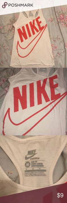 Nike tank Women's white Nike tank with orange letters. Size medium. Very comfy, great for running / working out in! Looks new Nike Tops Tank Tops