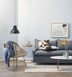Keep a restrained colour palette when decorating a small living room, and opt for a lounge that's  elevated off the ground to increase the feeling of space.  Styling  Sarah Cousens. Image Denise Braki.