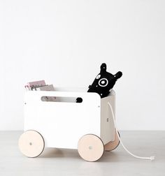 Ooh Noo Toy Chest On Wheel is it a toy that functions as a storage bin. This handmade wooden toy chest is a simple wagon and comes with a rope Baby Decor, Kids Decor, Wooden Toy Chest, Pram Toys, Deco Kids, Wooden Wagon, Baby Posters, Handmade Wooden Toys, Buy Toys