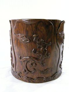 Brushpot. Huanghuali wood carved with dragons.