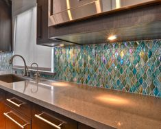 Tiles look like Mermaid scales!!! Xoxoxoxo would be great for a bathroom.