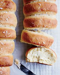 These fluffy, yeasty dinner rolls are finished with a glaze of melted butter and a sprinkle of sea salt.