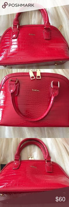 Bebe Red fashionable bag Bebe Red Fashionable Bag. Lovely red color great addition for any look. From smoke/pet free home. I usually ship same or next day. 😀 bebe Bags