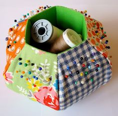 Hexie Pincushion, http://pennyshands.blogspot.com/2010/08/hexie-caddy-tutorial.html.  What an awesome tutorial