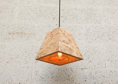 This Ceiling lamp shade is handmade from OSB recycled wood with a wire metal frame and metal mesh.
