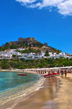 Lindos Beach Rhodes Greece this beach is beautiful it sure wasnt this packed when I was there