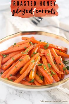 These roasted honey glazed carrots are Thanksgiving's easiest and tastiest side dish! Perfect for holidays or everyday side dish.