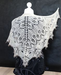 Ravelry: Vestland Shawl pattern by Anne-Lise Maigaard - Difficulty: Advanced. Charts only. Several charts are worked at the same time and the charts have pattern every row. Provisional CO is used. You will be asked to work in pattern as established.