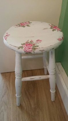 Shabby chic kitchen stool. Was plain pine. White chalk, distressed, waxed and decoupaged. Pretty.