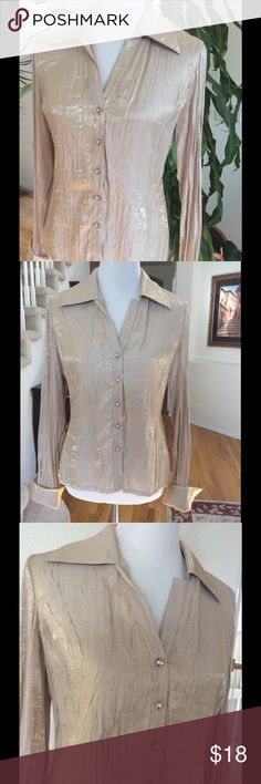 """Shimmery Gold Blouse Add the Midas touch with this gorgeous blouse! Shimmery gold with French cuffs & faceted crystal buttons. Wear with Velvet or lace or dress up your denim. Excellent pre owned condition. 75% rayon 25% nylon. Hand wash (I've washed on delicate in a lingerie bag) Dry flat. 39"""" bust 35"""" waist 40"""" hip 24"""" length from shoulder Bundle discount  ⭐️5 star rated Suggested User Smoke free home No trades please   Thank you for shopping with me. Please ask all questions before…"""