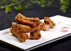 The best crispy fried wings ever - and what a nice surprise: they're easy to make too. Unlike most deep fried ribs that I've tried, these are not just about the coat, but full flavor all the way through. The special Thai marinade is what does it.