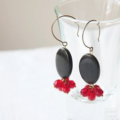 Earrings Oval black horn and faceted red glass beads by emeeme, $18.00