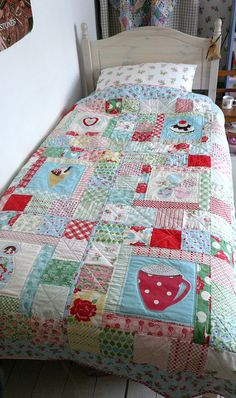 What a beautiful quilt for a little girl's room! We love how colorful and springy this twin bed quilt is.